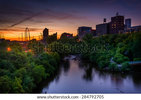 Sunset over the Mississippi River and Marcy-Holmes, in Minneapolis, Minnesota. - stock photo