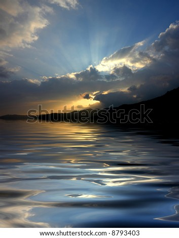 sunset over the mountains, with water reflection - stock photo