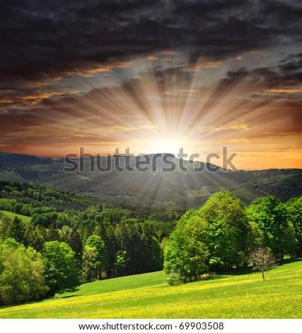 sunset over the national park Sumava in Czech Republic - stock photo