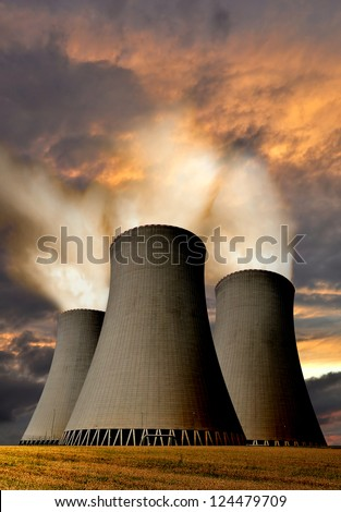 Sunset over the nuclear power plant - stock photo