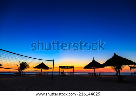 Sunset over the ocean at a tropical resort - stock photo