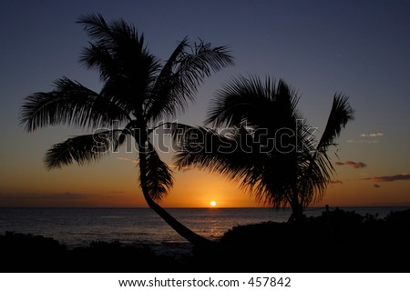 Sunset over the Pacific from Paradise Cove, Oahu - stock photo