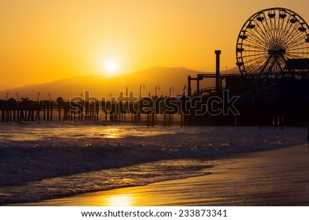 Sunset over the Pacific Ocean at Santa Monica Beach, in Southern California.