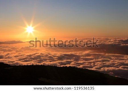 Sunset over the Pacific Ocean from Mount Haleakala on Maui, Hawaii