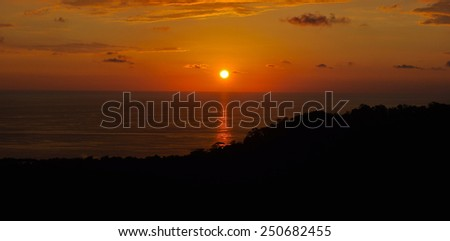 Sunset over the Pacific Ocean in Costa Rica - stock photo