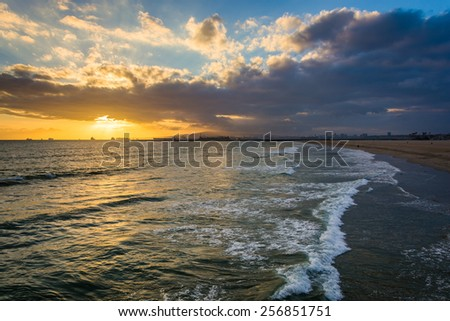 Sunset over the Pacific Ocean, in Seal Beach, California. - stock photo