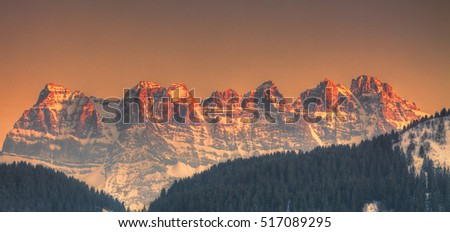 Sunset over the pics on Dents du Midi situated in the Chablais Alps in the Swiss canton of Valais.