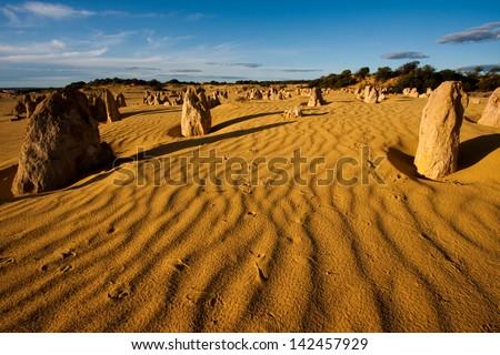 Sunset over the Pinnacles desert in Western Australia. - stock photo