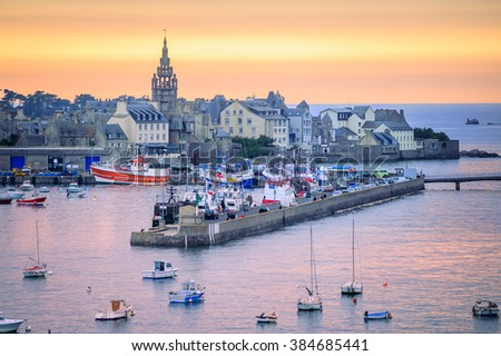 Sunset over the port of Roscoff, a popular tourist destination in Finistere departement of Brittany in northwestern France - stock photo