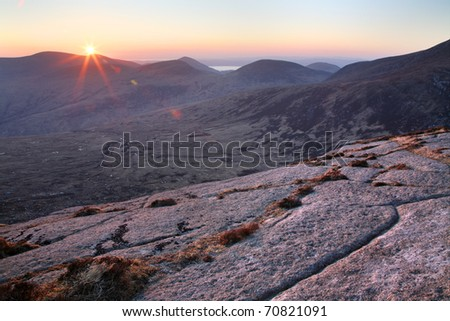 Sunset over the remote northern part of the Isle of Arran in Scotland. - stock photo