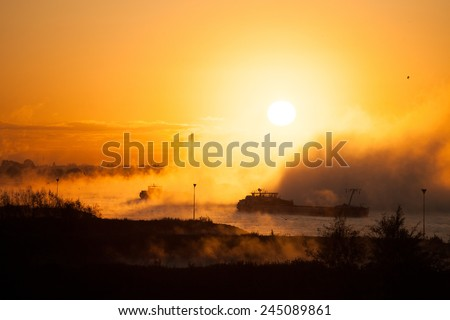 Sunset over the river Rhine - stock photo