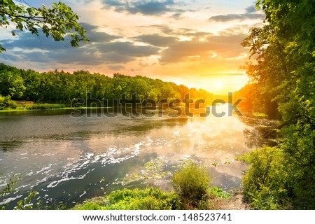 Sunset over the river Severskiy Donets in the forest - stock photo