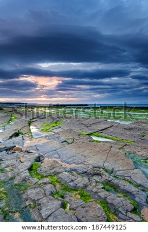 Sunset over the rugged coast of Donegal, Ireland - stock photo