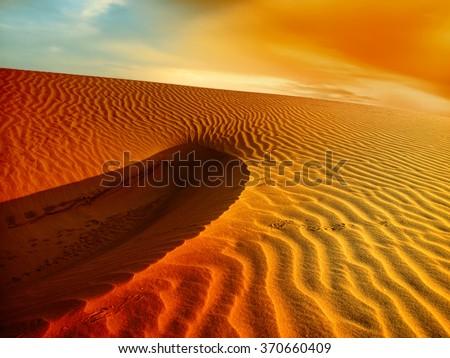 Sunset over the Sahara Desert - stock photo