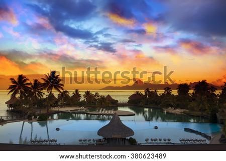 Sunset over the sea and mountains, Tahiti. - stock photo