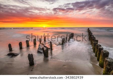 sunset over the sea beach - stock photo