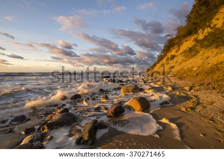 sunset over the sea beach,Wolin national park, baltic sea - stock photo