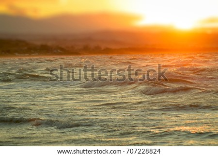 stock-photo-sunset-over-the-sea-reflecti