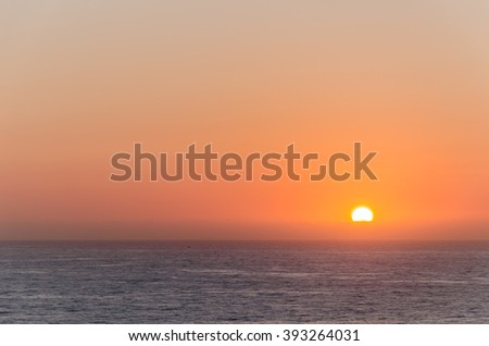 sunset over the sea, scenic seascape at evening - stock photo