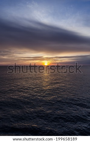 sunset over the sea with vibrant colors