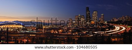 Sunset over the Seattle skyline, Puget Sound, and the Olympic Mountains. - stock photo