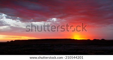 Sunset over the Teepee area of Petrified Forest National Park, Arizona.  - stock photo