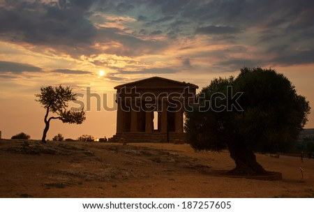 Sunset over the Temple of Concordia, Agrigento, UNESCO World Heritage, Sicily in Italy - stock photo