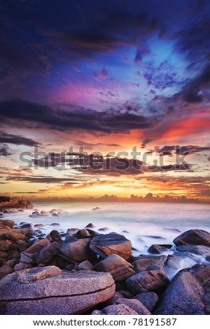 Sunset over the tropical bay. Long exposure vertical shot. - stock photo