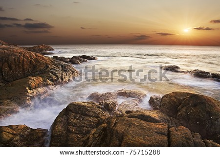 Sunset over the tropical sea ( long exposure shot ) - stock photo