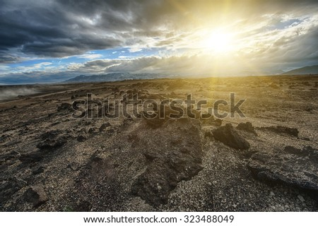 """Sunset over the vast volcanic """"Moon like"""" desert with rocks of lava hidden in the highlands of Iceland which makes it accessible only with a powerful 4x4 vehicle. HDR - stock photo"""