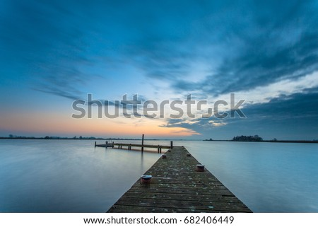 Sunset over the waters of lake Leekstermeer in the Netherlands