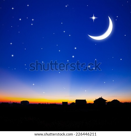 Sunset over town with moon and stars