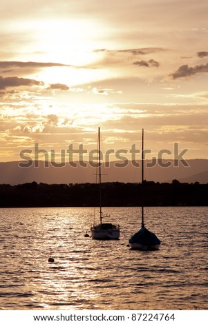 Sunset over two Boats - stock photo