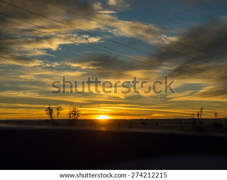 Sunset over U.S. Route 82 in New Mexico in December.