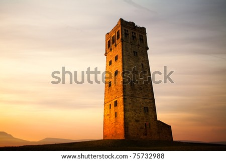 Sunset over Victoria tower on the Castlehill in the Huddersfield. - stock photo
