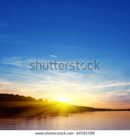 Sunset over water. - stock photo