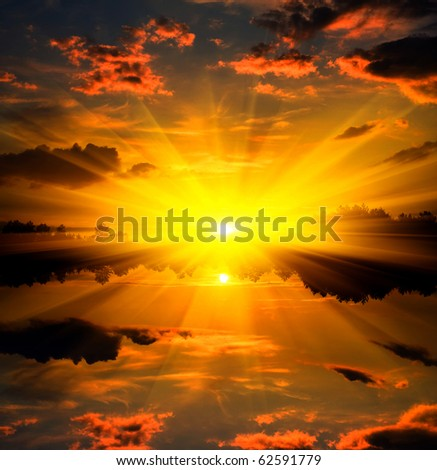 Sunset over water reflection - stock photo
