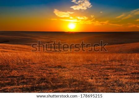 Sunset overlooking the Flint Hills of Kansas. - stock photo