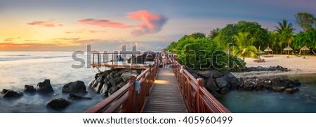Sunset Panorama of a bridge in the north coast of Mauritius - stock photo