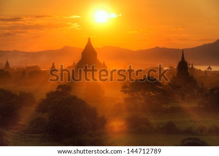 sunset panorama of many Bagan temples and rice fields, Burma