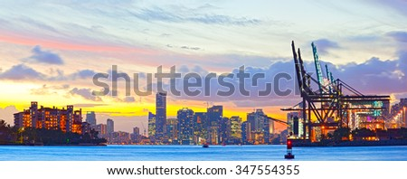 Sunset panorama of Miami Port, Fisher Island and downtown, colorful city light and Biscayne Bay water - stock photo
