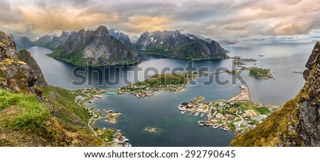 Sunset panorama of  mountains and  Reine in Lofoten islands, Norway viewed from the Mt. Reinebringen - stock photo