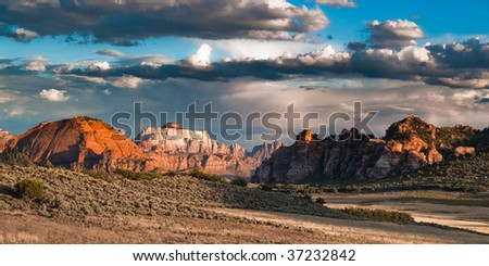 sunset panorama of sandstone cliffs at kolob plateau in zion national park, utah, usa - stock photo