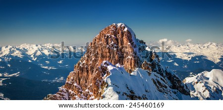 Sunset Panorama over The Three Valleys in France the largest ski domain in the world as seen from one of the peaks in Courchevel - stock photo