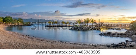 Sunset panorama view of the North coast of Mauritius in Balaclava with Port-Louis in the background - stock photo