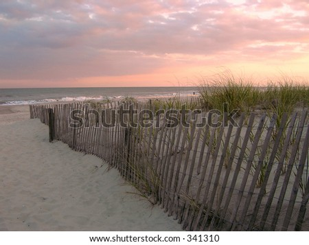Sunset photo of beach and dunes in Ocean City, New Jersey. - stock photo