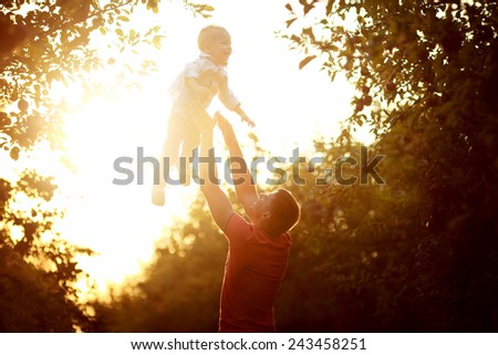 Sunset photo of father and son - stock photo