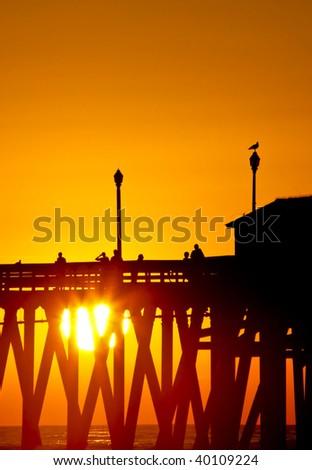 sunset pier - stock photo