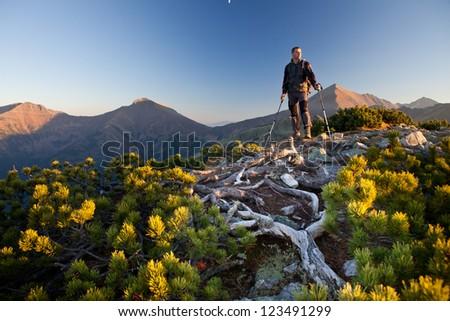 Sunset portrait of hiker in Tatra Mountains, Ornak Peak, Poland - stock photo