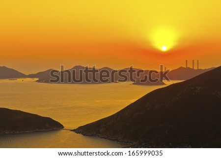 Sunset power plant at coast